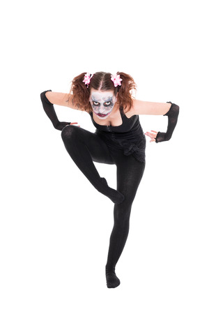 scary ballet dancer is posing in front of white Stock Photo