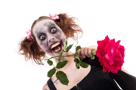 insane woman with a red rose in front of white photo