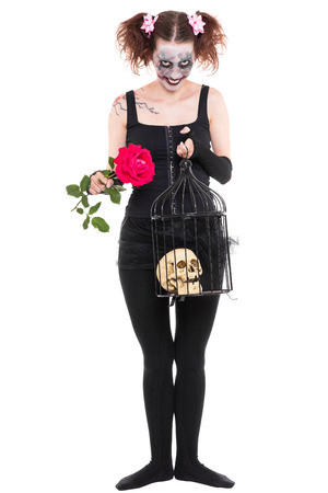 a insane woman with rose and skull isolated on white photo