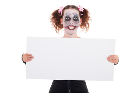 insane smiling female clown with empty sign Stock Photo