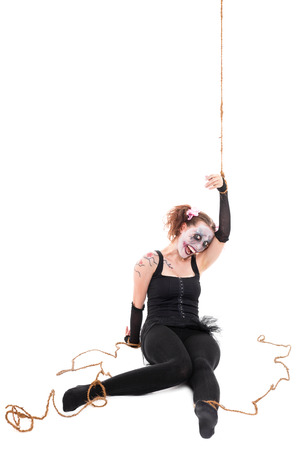 insane creepy human puppet is smiling, isolated on white photo