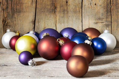 colorful christmas balls on a wooden background photo