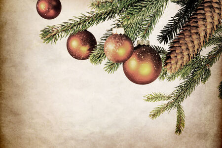 brushwood: fir branch and cone with balls, vintage filtered background