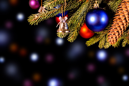 colorful christmas background with lights, balls and fir cone photo