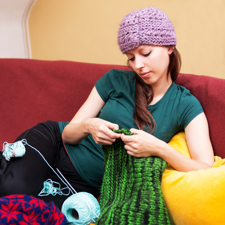 colorful background with knitting woman on a couch photo