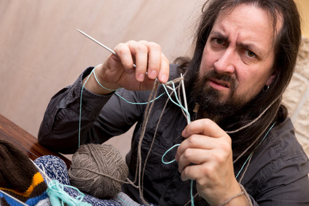 a desperate man is trying to knit photo