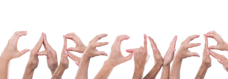 caregiver: lot of hands form the word caregiver Stock Photo