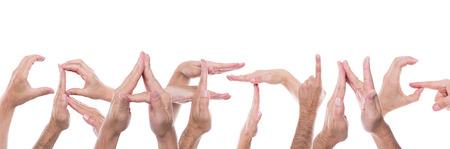 crafting: mont�n de manos forman la palabra elaboraci�n Foto de archivo