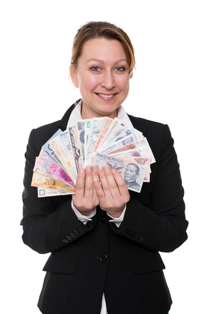 traded: Businesswoman is holding widely traded currencies in the hands