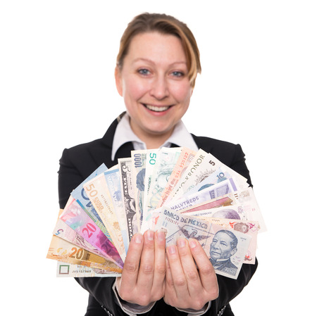 emerging economy: woman holding widely traded currencies in the hands