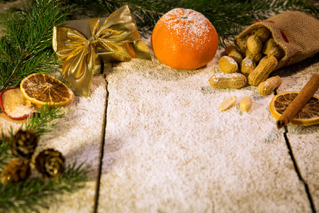 many christmas fruits on a sugared table photo