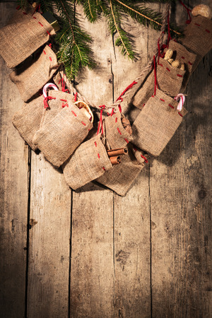 advent calendar with little sacks on a wooden background Stock Photo