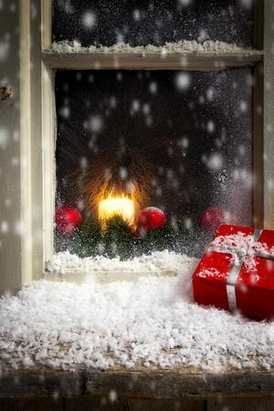 snow falls: romantic christmas decoration on a window 3 Stock Photo