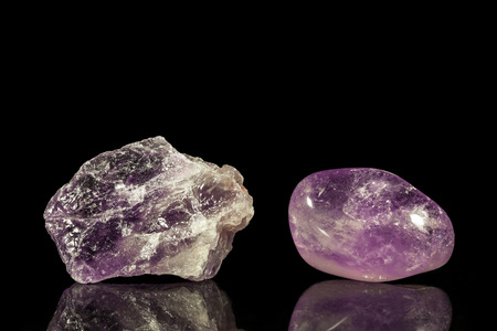 uncut: Amethyst, uncut and Tumble finishing with black background and reflection Stock Photo