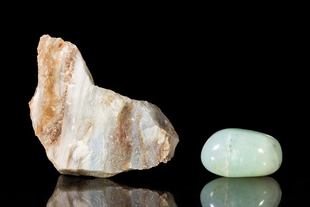 Andes, opal, uncut and Tumble finishing with black background and reflection photo