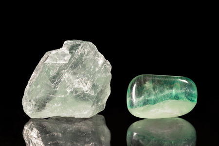 fluorite: Fluorite, uncut and Tumble finishing with black background and reflection