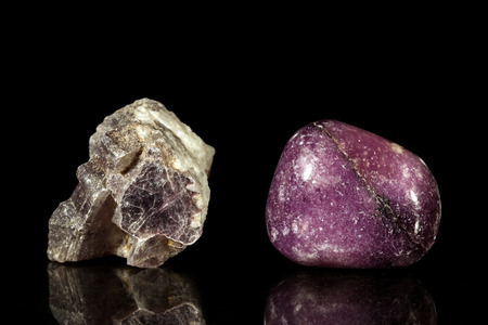 uncut: lepidolite, uncut and Tumble finishing with black background and reflection Stock Photo
