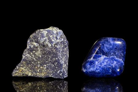 semiprecious: sodalite, uncut and Tumble finishing with black background and reflection Stock Photo