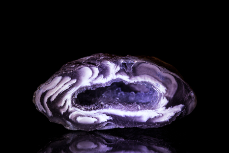 Lilac Agate Druse in front of Black photo