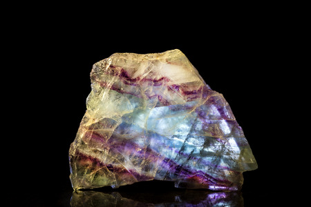 mineral stone: Fluorite Mineral Stone in front of Black Stock Photo