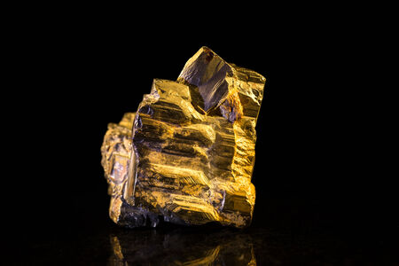 mineral stone: Pyrite mineral Stone in front of Black
