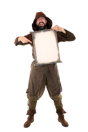 adventurer: funny medieval man is holding a old aged scroll with copyspace