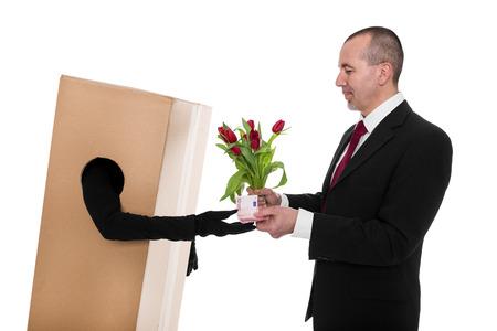 deliverer: Concept: a Businessman ordered a flower deliverer Stock Photo