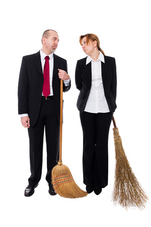inappropriate: group of business people with brooms making a inappropriate working