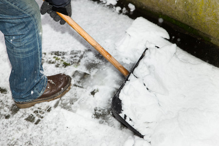 shoveling: closw up, man is snow shoveling a path Stock Photo