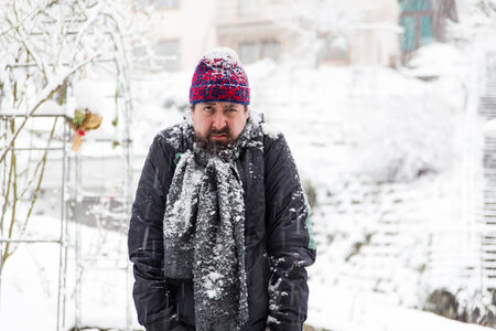 grumpy: a grumpy man in a snowy garden