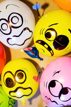 cause: Funny balloon faces are scared cause of danger Stock Photo