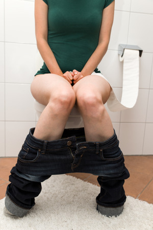 pee pee: Concept: a woman is suffering about congestion or diarrhea