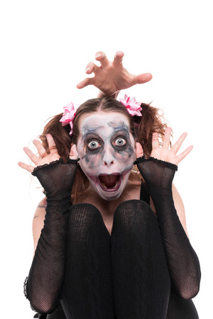 psychopath: funny woman with creepy makeup in front of white