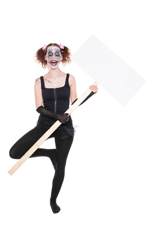 insane female ballet dancer or clown with an empty sign photo
