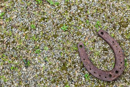 a Horseshoe on gravel ground for good luck