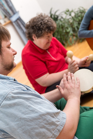 music therapy: a music therapy with a mentally disabled woman Stock Photo