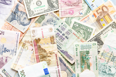 foreign currency: many different currencies as colorful background concept global money Stock Photo