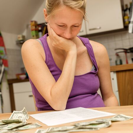 financial problems: young pregnant woman with a lots of financial problems