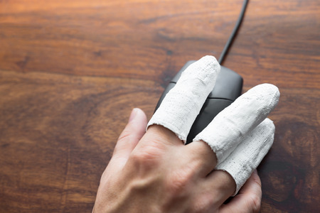 incapacitated: a  hand with PC mouse, concept incapacitated, handicap