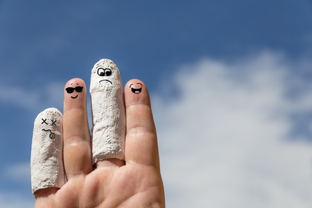accident patient: hand in front of blue sky, injured finger, concept insurance or accident