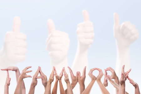 team hands: the word teamwork in front of hands holding thumbs up Stock Photo