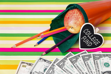 orange school cone with money, concept and text college fund photo