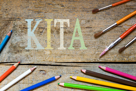 kita: wooden vintage background with the german word for nursery