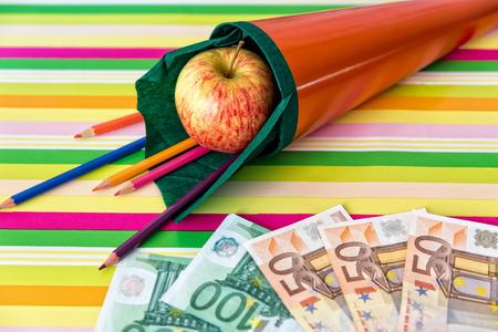 orange school cone with money, concept college fund photo