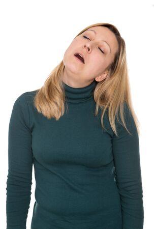 cansancio: Mujer bonita está durmiendo de pie Foto de archivo