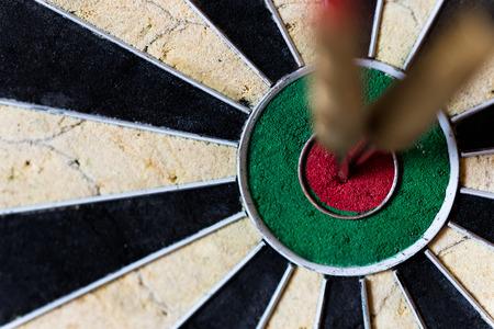 bullseye: closeup of a Dartboard with Steeldarts in bullseye