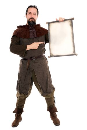 adventurer: a medieval adventurer is holding a old scroll with copyspace Stock Photo