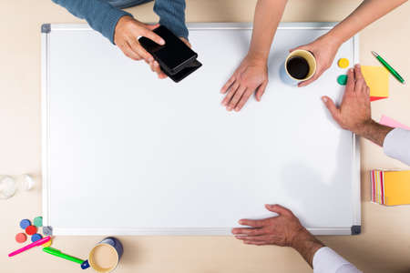 man writing: whiteboard with copy space, three persons and top view, concept business