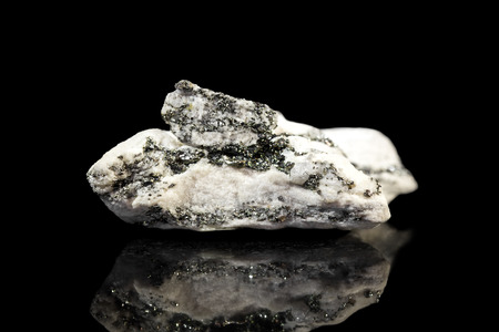pyrite: white dolomite mineral stone with pyrite, gemstone with reflections, black background Stock Photo