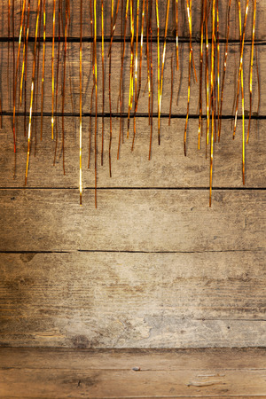 the tinsel: wooden background with tinsel and golden shine